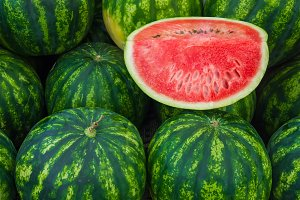 Ripe watermelons on a market stall