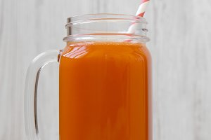 Glass jar of carrot smoothie