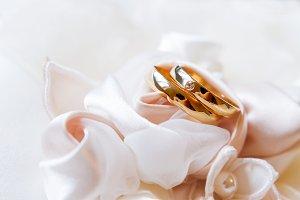Golden wedding rings with diamond
