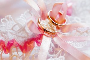 Pair of golden wedding rings on lace