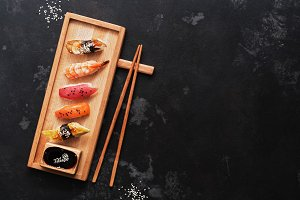 Assorted sushi set on a wooden plate