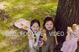 Three girls standing near the tree