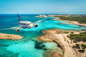 Airplane is flying over islands