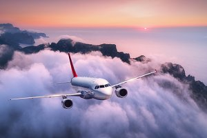 Airplane is flying over clouds