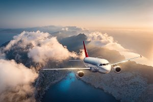 Airplane is flying over mountains