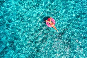 Aerial view of girl in the sea