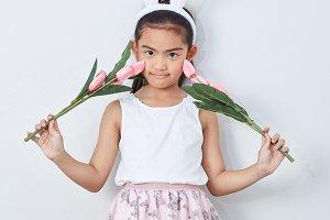 little girl holding bouquet tulip