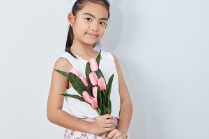 little girl holding bouquet tulip