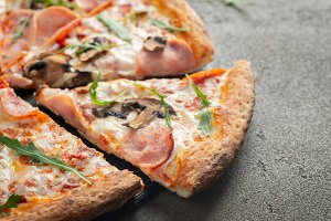 Delicious hot pizza with ham and cha