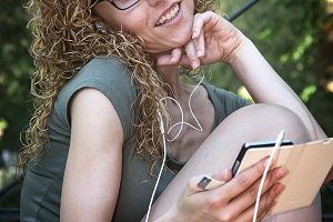 Attractive blond girl listening to m