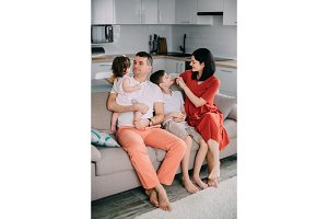 Happy family sitting on couch at