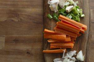 Desk with carrot, onion, garlic