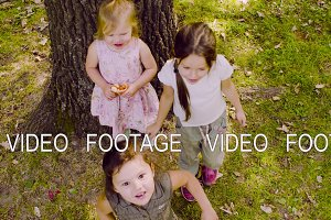 Three girls playing in the park on