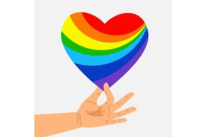 Human hand hold rainbow heart. LGBT