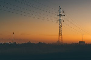 Power line support during sunrise