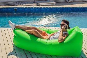 Young man enjoying leisure, lying on
