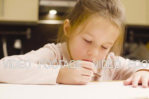A girl drawing pastel crayons on
