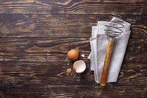 Vintage wooden whisk and eggshells