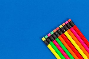Colorful pencils on blue