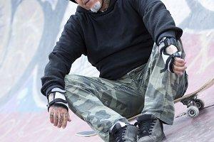male skater sitting down
