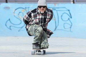 middle aged man skating crouched