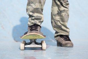 skater feet and skateboard