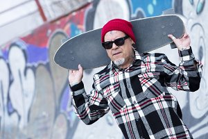 skater holding his skateboard