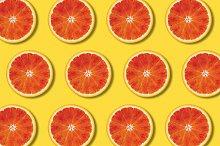 Red orange slices pattern on yellow