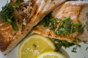 roasted salmon with herbs on a dish