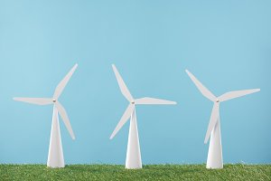 white windmill models on grass and b