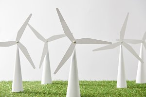 windmill models on grass and white b