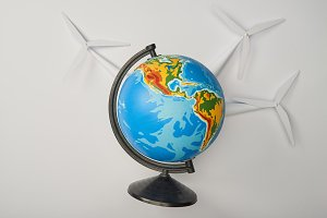 globe with windmill models on white