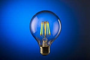 Light bulb with blue background