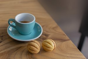 Cup of coffee and wooden table