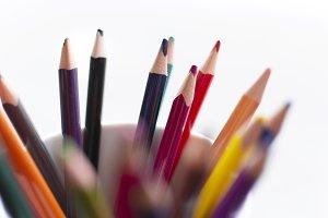 Kids color pencils in pot