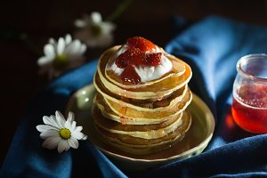 Pancakes with berries and yogurt on