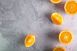 Cutted oranges on the gray backgroun