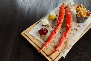 Cooked king crab legs with sauces