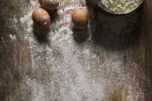 Eggs and flour on a sieve with a woo