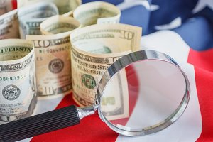 Magnifying glass and American dollar
