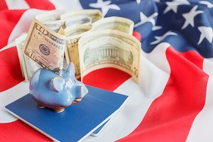 Piggy bank, blue passports and Ameri