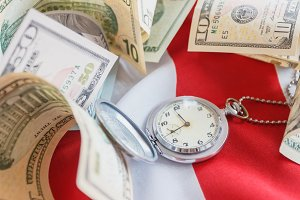 Pocket watch and American dollars on