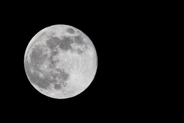 Stock Photos: Oleksandr Masnyi - Full moon in the black sky.