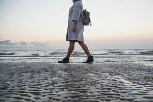 Woman in coat walking on the