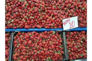 Fresh organic strawberry in street