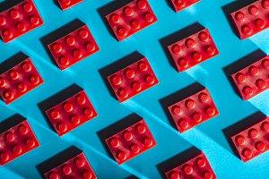 Red plastic geometric cubes contrast