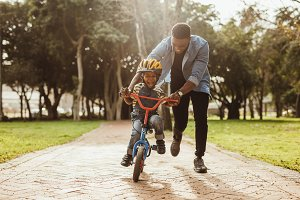 Father teaching his son cycling