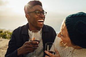 Happy couple with wine enjoying
