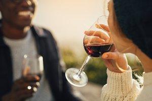 Woman drinking wine on picnic
