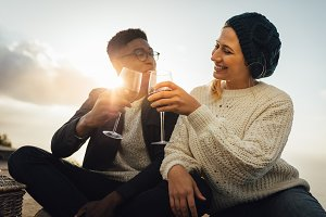 Young couple drinking wine and enjoy